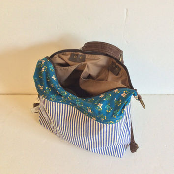 Railroad stripe cotton jeans backpack with convertible strap for multiple ways to carry in one bag, blue and white stripes and floral cotton