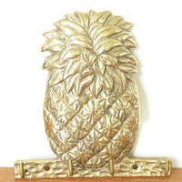 Wall mounted brass pineapple key holder with four hooks