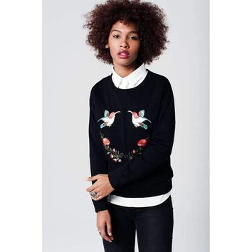 Black soft knit sweater with bird and flower embellishment