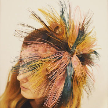 Fascinator , individually attached peacock feathers and hair comb.