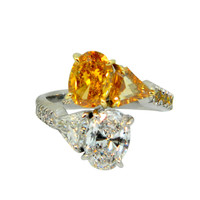 Fancy Vivid Orange-Yellow and D Internally Flawless Oval Diamond Bypass Ring