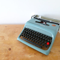 Blue 1960s Retro Portable Typewriter- Olivetti Studio 44. Made in Italy. In Good Working and Aesthetic Condition.