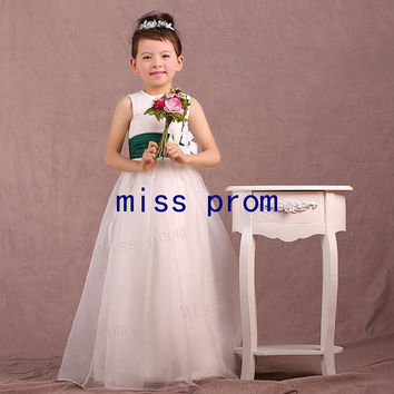 Organza flower girl dress with green sash and flowers