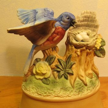 Vintage Ceramic Music Box of a Blue Bird and her Nest of Eggs