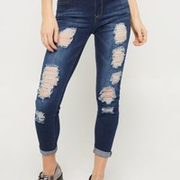 Dark Wash Mid Rise Destroyed Skinny Jeans in Regular