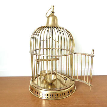 Medium size brass birdcage with swing open door, 14 inches tall