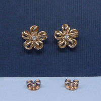 A rose gold plated filigree floral with white crystal blossom ear studs, a disco jewlery, tea party earrings.