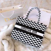 shosouvenir  DIOR BOOK TOTE BAG IN BLACK AND WHITE EMBROIDERED CANVAS