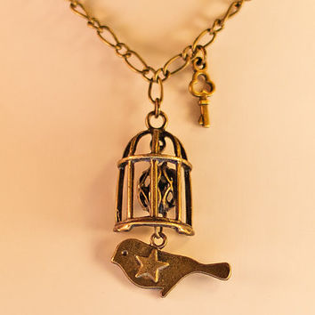 Bird in cage bronze pendant necklace with chain and key. Freedom