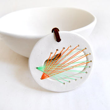 Round White Ceramic String Art Pendant with Different Combinatios of Colors Green, Yellow, Pink, Orange and Light Brown