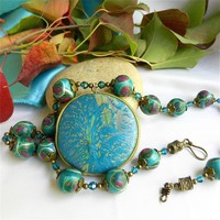 Teal and Bronze Harmonize in the Polly_Ceramica Pendant Necklace