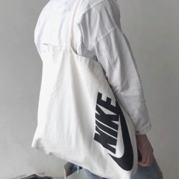 NIKE New fashion letter hook print couple shoulder bag shopping bag canvas bag White