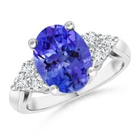 Oval Tanzanite Cocktail Ring With Trio Diamond Accents