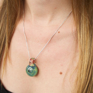 Swirling green and blue embryo, boro glass pendant with contrasting bale