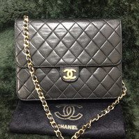Special. 70's, 80's Vintage CHANEL black lambskin chain shoulder bag, classic 2.55 purse with gold tone CC closure.
