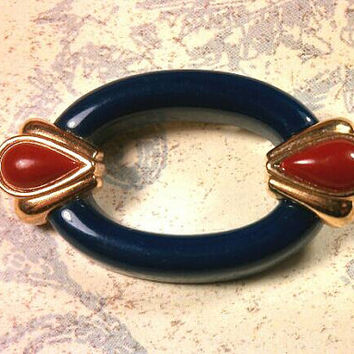 Oval Navy Royal Blue and Orange Red gold tone lucite plastic pin. Retro!