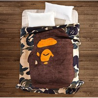 ca kuyou A Bathing Ape / Bape Coral Fleece Blanket on the bed Camouflage