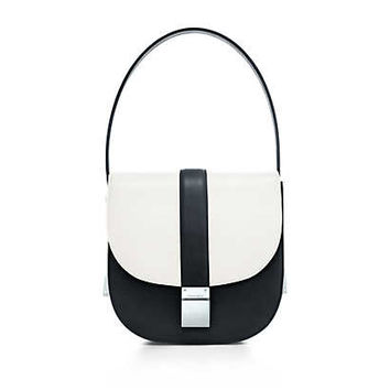 Tiffany & Co. - Tulip shoulder bag in smooth and grain leather. More colors available.