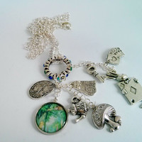 Alice in Wonderland charm necklace - blue, green and silver gem ring