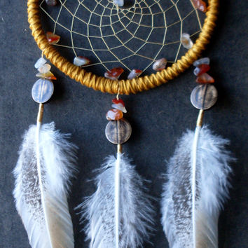 Yellow dreamcatcher with natural stones and feathers