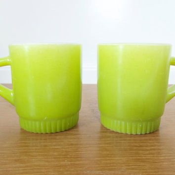 Two Anchor Hocking Fire King stackable light green mugs with ribbed bottom, oven safe
