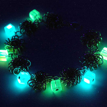 Glow in the dark handmade bracelet with glow glass beads (silver and gold rings)