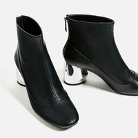 ANKLE BOOTS WITH METAL HEELDETAILS