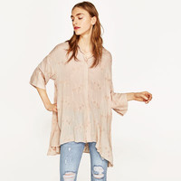 EMBROIDERED OVERSIZED BLOUSE DETAILS