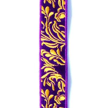 Bracelet of purple background with gold leafs