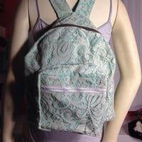 Mint green backpack with lace overlay
