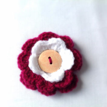 Red and white crocheted flower brooch.