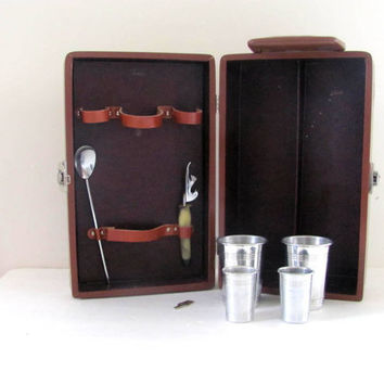 Vintage Mid Century Travel Bar. shot glass and liquor bottle carrying case