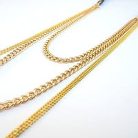 Black leather and gold plates chains necklace