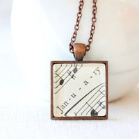 January birthday necklace.  Vintage sheet music necklace with word January under glass on chain.  Gift for capricorn or aquarius
