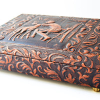 "Music cigar box made of wood covered in leather embossed paper. On the occasion of ""Don Quixote"""