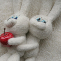 Two bunnies on a pillow and Eves apple