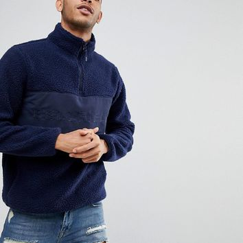 Bellfield Half-Zip Overhead Jacket In Teddy Fleece at asos.com