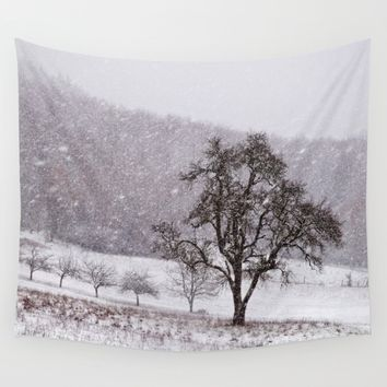 Old pear tree on a wintery meadow Wall Tapestry by Pirmin Nohr