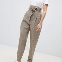 ASOS DESIGN Balloon tapered trousers in Heritage check at asos.com