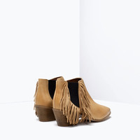 Fringed high heeled leather booties