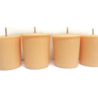 Honeysuckle scented soy votive candles, peach colored candles
