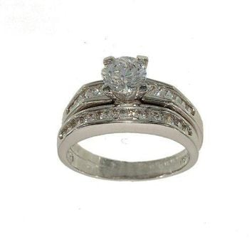 Silvertone Two Piece Fashion Ring Wedding Set Includes Round Solitaire with Channel Set Sides and Matching Channel Set Wedding Band in Genuine Cubic Zirconia