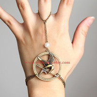 The Hunger Games pendant  Mockingjay Arrow and Peeta pearl bracelet and ring