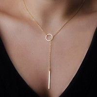 Gold Lariat Y Necklace with Vertical Bar Looped Through Circle