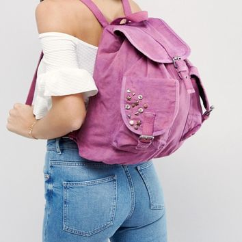 ASOS Canvas Acid Wash Backpack with Studs at asos.com