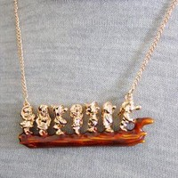 Golden Seven Dwarfs on a log Necklace. from PAISIE
