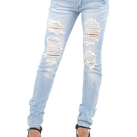 Shop Trendy Juniors Machine Ripped Skinny Jeans (Light Blue) in Jeans