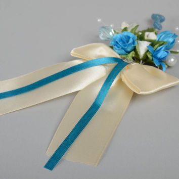 Beautiful homemade fabric boutonniere brooch of light color for groom or bride