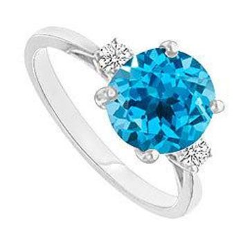 Blue Topaz and Diamond Ring : 14K White Gold - 0.75 CT TGW