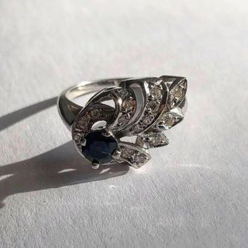 14k White Gold: 1 Sapphire and 18 Diamonds Cocktail Ring